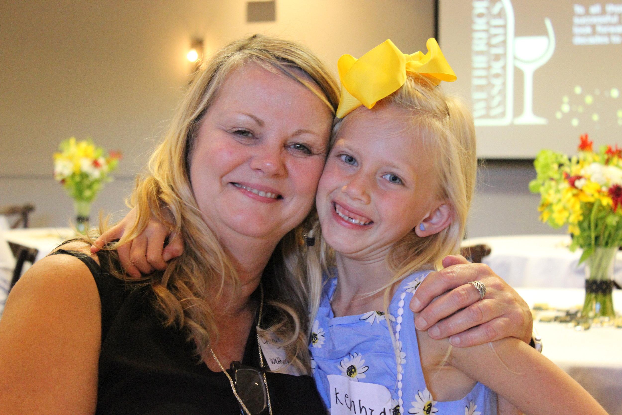 Wetherholt Billing Manager, Cheryl Olson, and her granddaughter, Kennedy