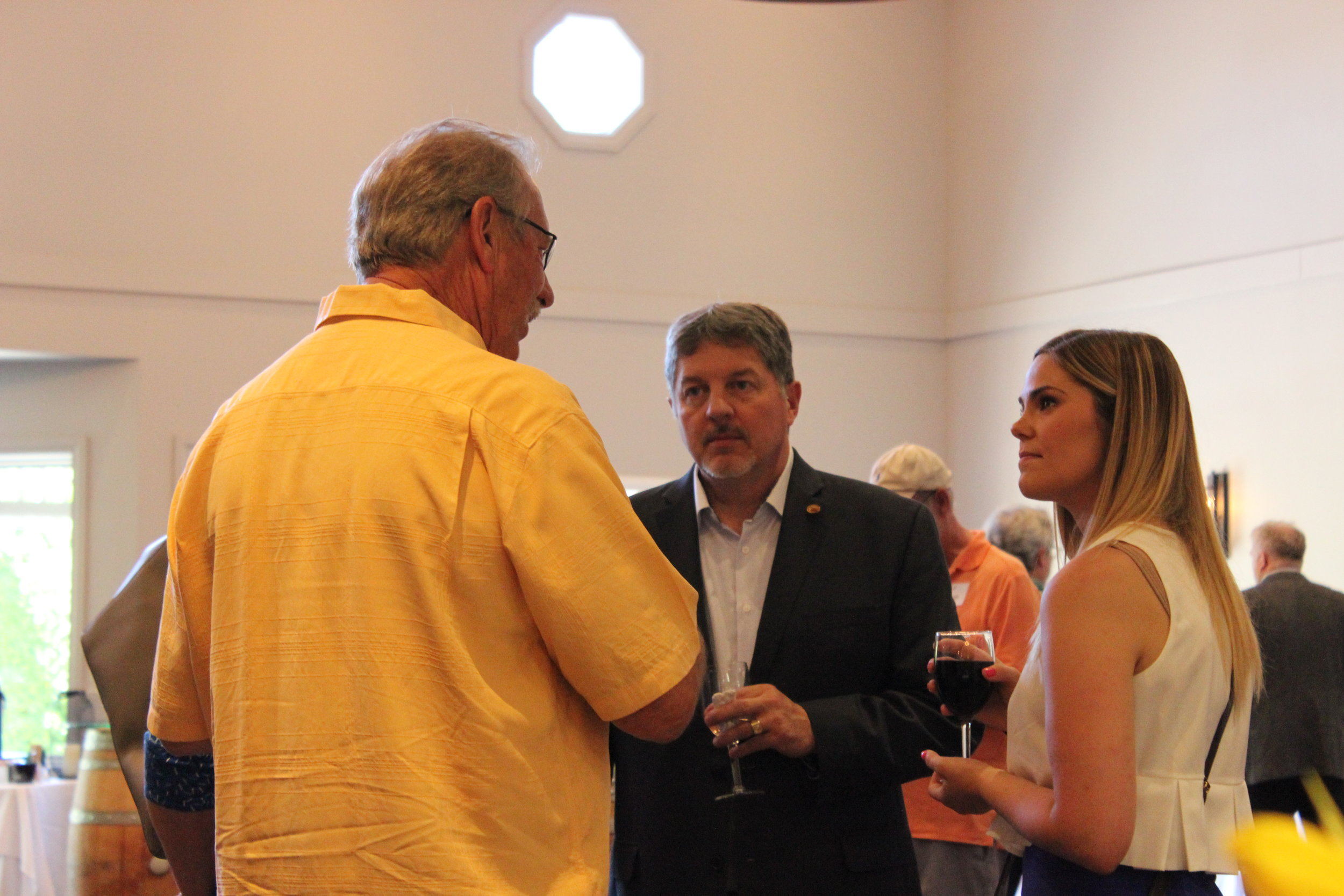 Wetherholt Principal, Bob Card, with guests