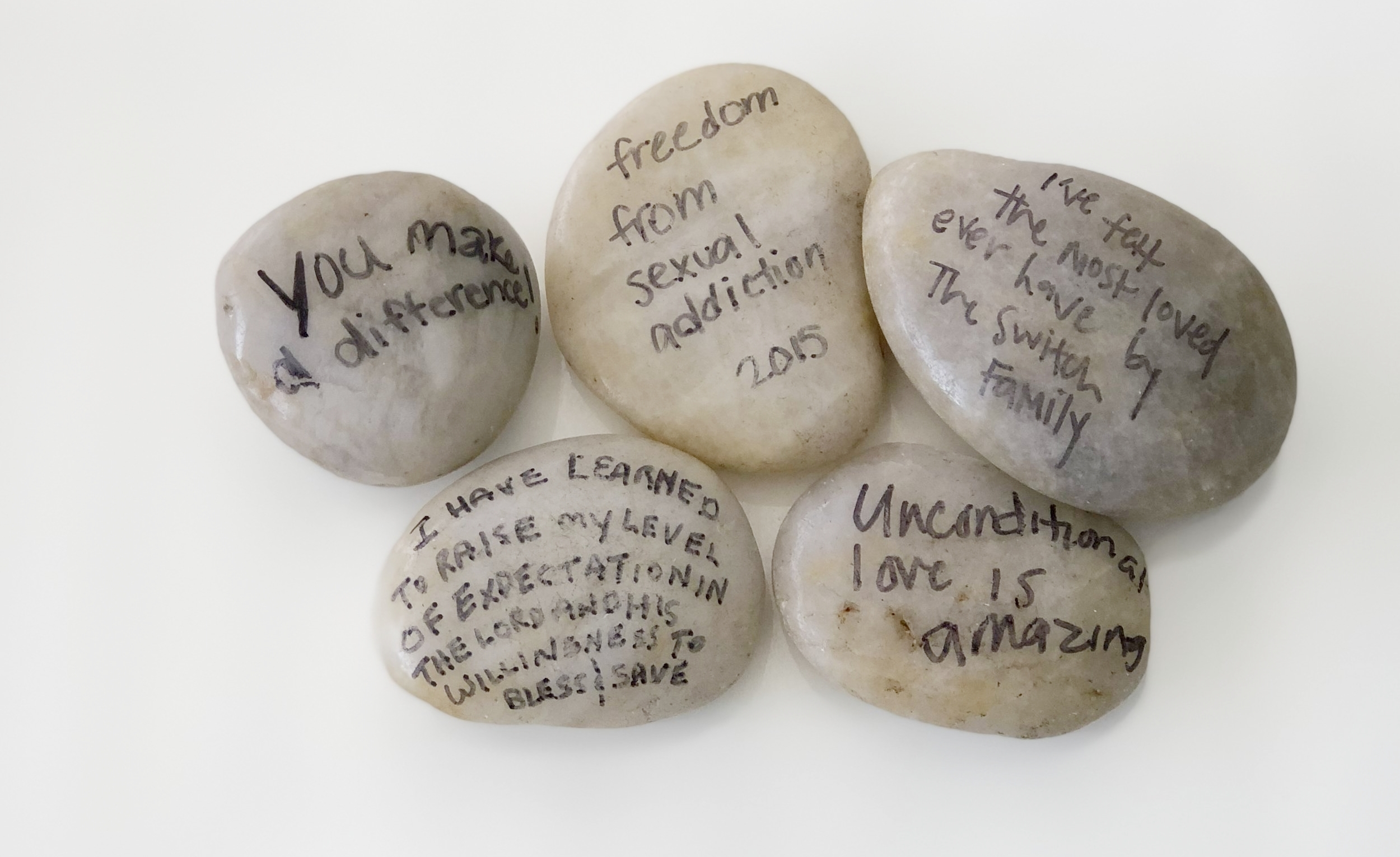 Our stone pile. There are many stones around our office celebrating the successes we have seen written by participants, staff, board and volunteers.
