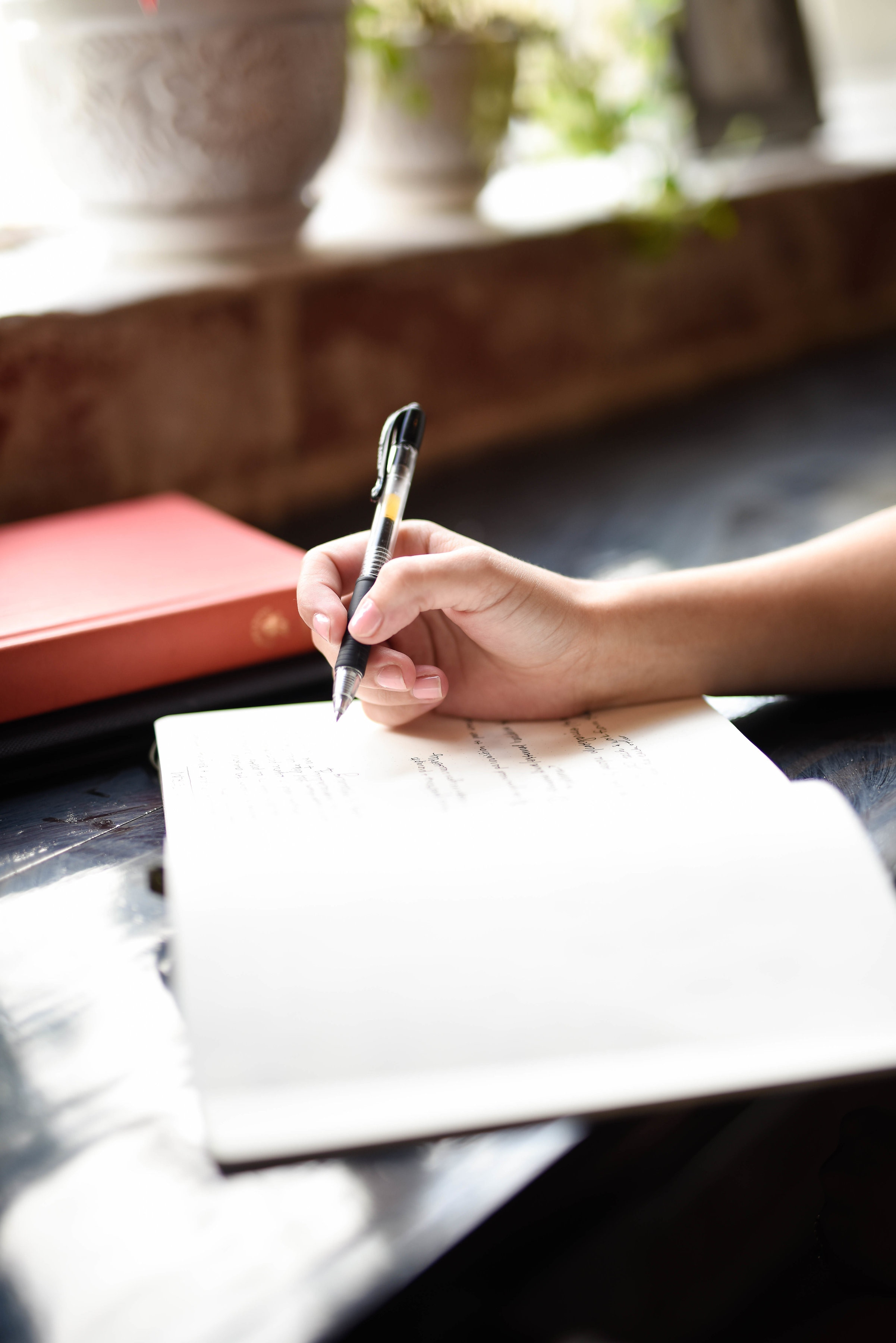 woman hand writes wedding vows.jpg