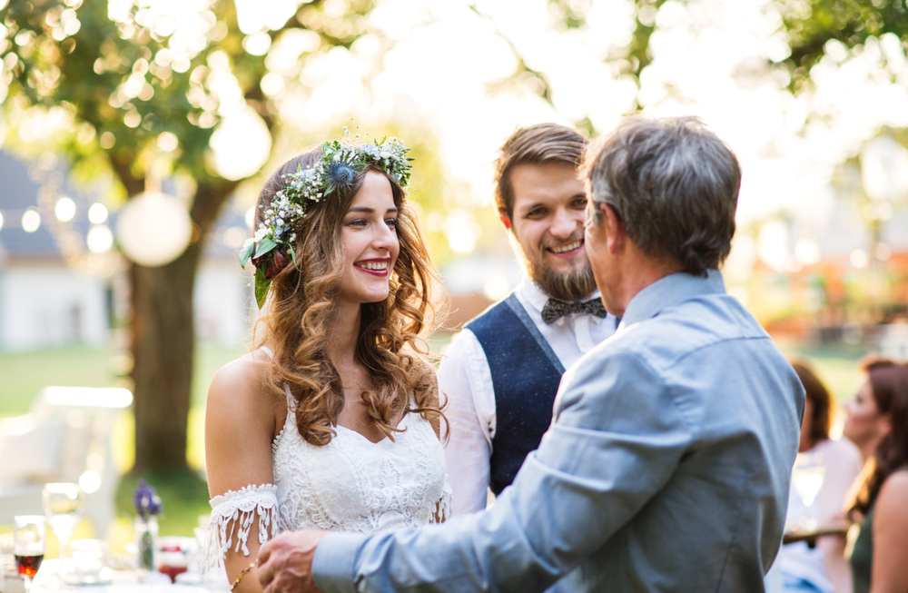father of groom welcomes new daughter-in-law into his family.jpg