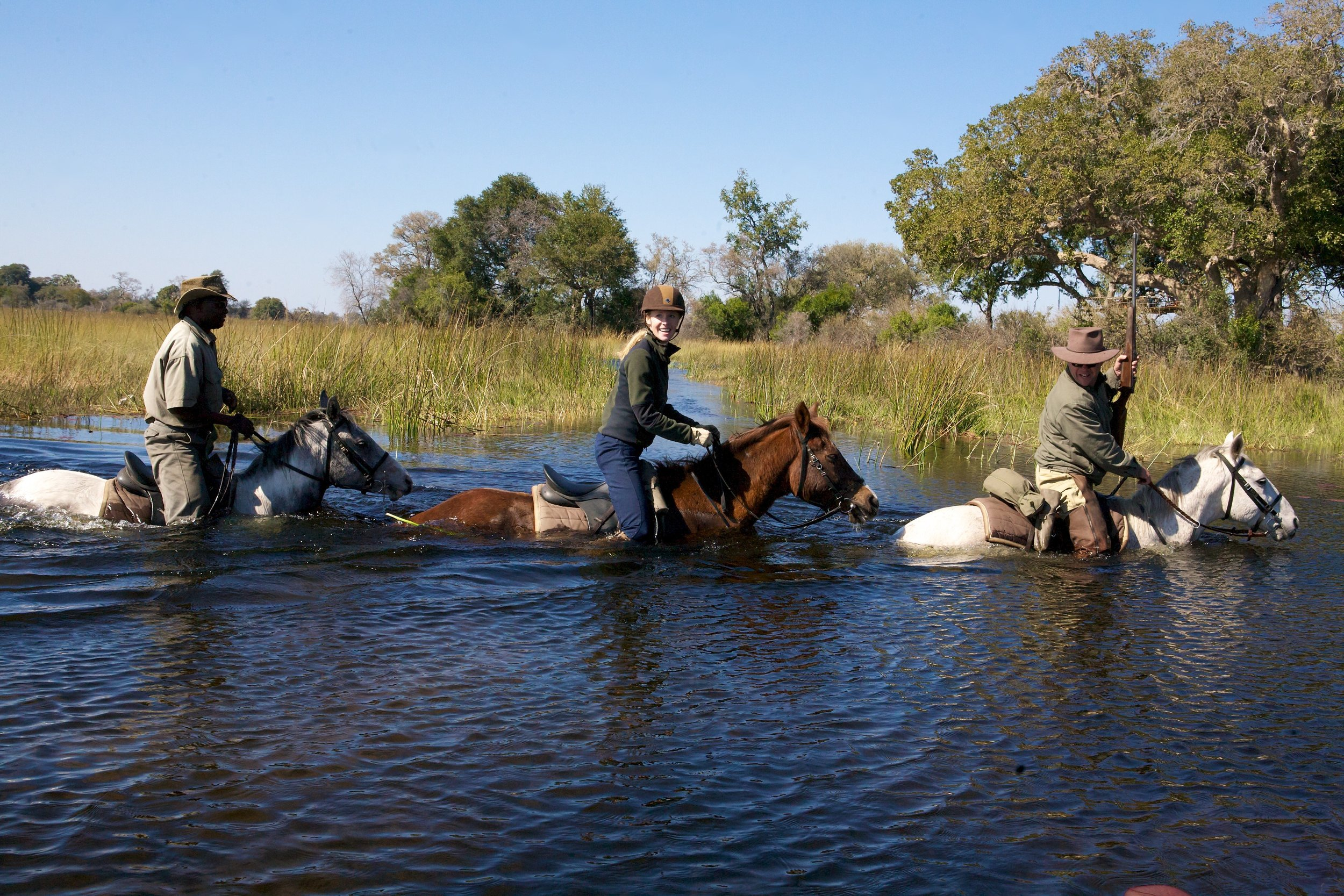 Darley riding in Botswana's Okavango Delta, photo courtesy Equitrekking  Cover photo: Darley with meerkats in Botswana, courtesy Equitrekking  (true, they're not horses… but they're so CUTE!)