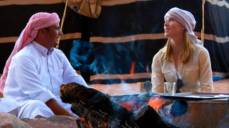 Darley enjoying a campfire with her Bedouin host, photo courtesy Equitrekking.