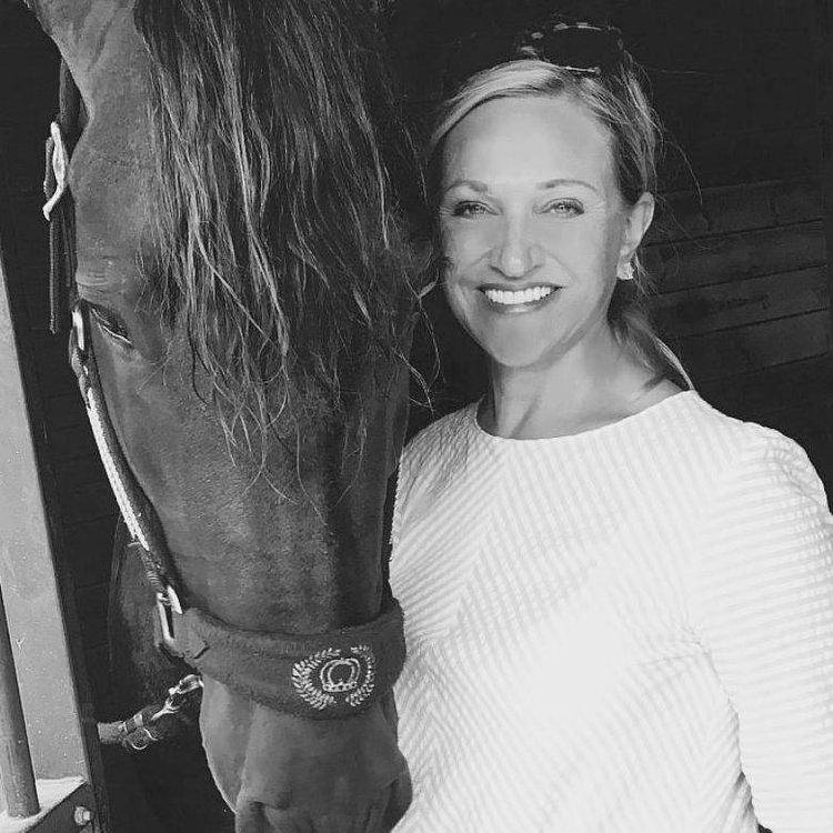 Photo of Kimberly Van Kampen with PRE stallion Brio, courtesy Hampton Green Farm, by Lily Forado