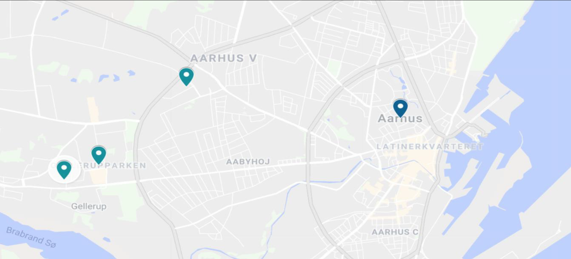 "The three ""ghetto"" neighborhoods of Aarhus in light blue, city center in dark blue: (from left to right): Børnehaven Skovgårdsparken, Gellerupparken, and Bispehaven"