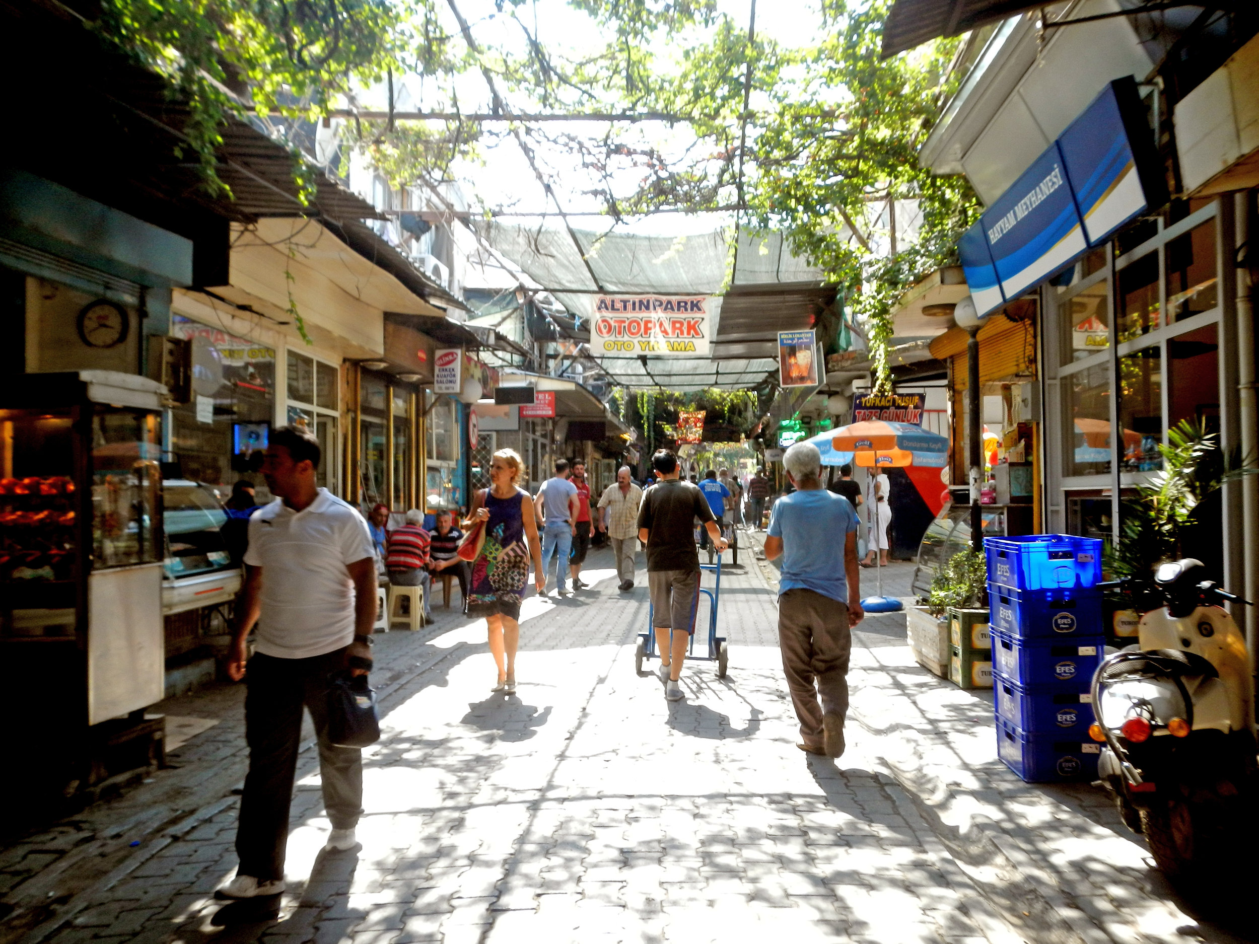 A shopping area in Basmane where one can find Syrian barber shops, grocery stores, vegetable and fruit vendors, electronics stores, cafes, restaurants, money transfer vendors, and smugglers.