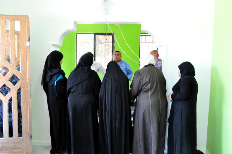 A group of refugee women meeting with a local NGO in Amman.