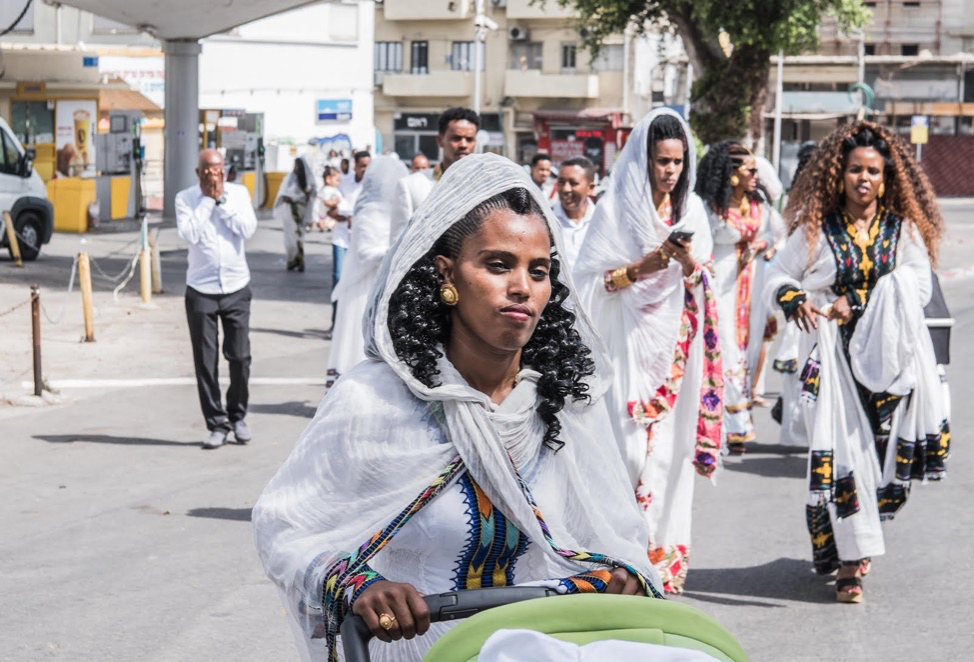 Figure 2:  Eritreans on their way to a park after a baptism ceremony in church. South Tel Aviv, 2018. Used with permission from  Jonathan Small Photography . Click to enlarge.
