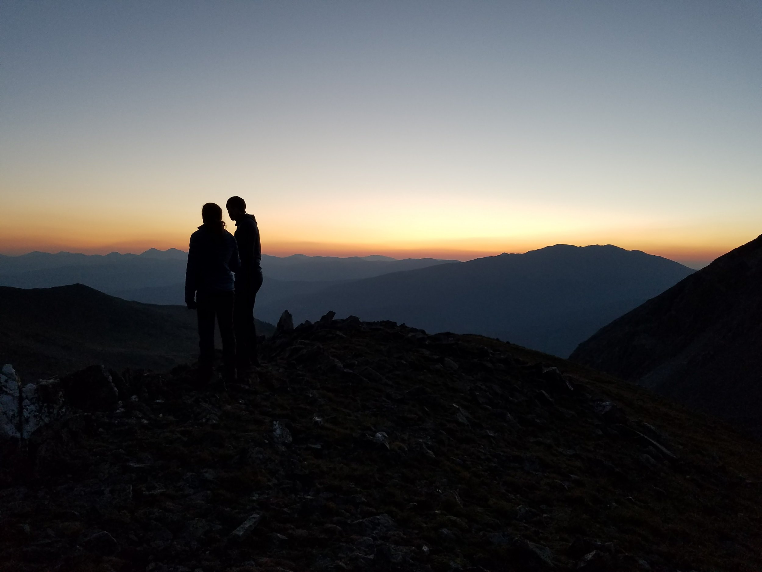 Owen and Emily enjoying the pre-dawn view of Summit County from the East Ridge of Father Dyer.  Photo: Mike Hasse