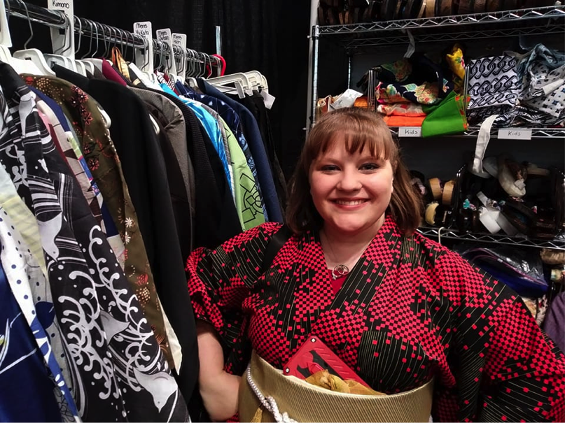 Sherri Santellano promoting Tangerine Mountain Imports and Designs. They were selling kimonos in all shapes and sizes, even in plushie size.