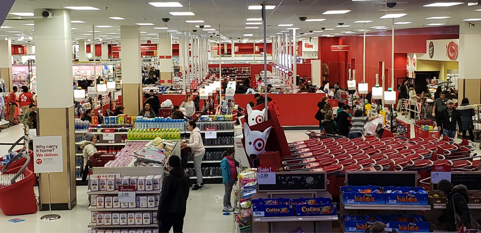 Target Department Store at 225th in the Bronx. At 7:05PM the lights of almost all Self-Checkout registers appear to be lit indicating the register is open. Behind them the lights of only 4 out of 29 available manual registers that require team members are lit. Photo by Perla Tolentino.