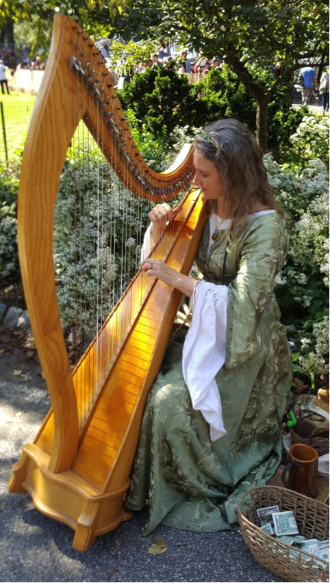 Kathleen Finnegan strums a Celtic melody on the harp. Photo by Brittany Aufiero.