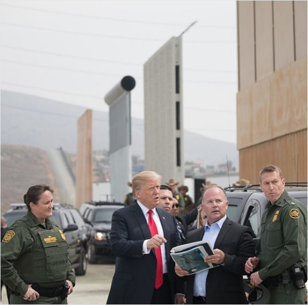 President Trump views border wall prototypes. Photo courtesy of Wikimedia Commons.