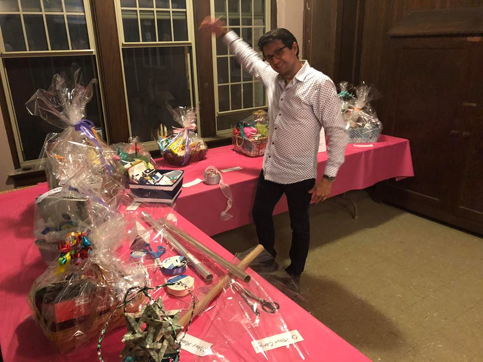 Crossfire 2018! Paul Detaege looking over some wonderful gift baskets!