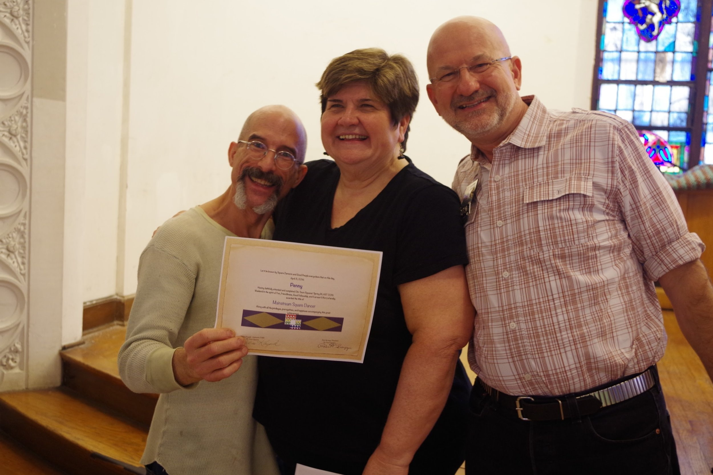 Penny receiving his Mainstream Blast graduation certificate, with Club Caller Arlene Kaspik and Board President Rob Sierzega. April 3, 2016.