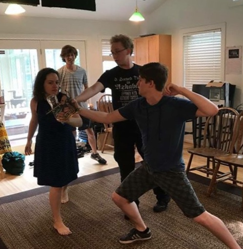 Ian Claar works with actors on a fight using found objects for  J-Swizzle and D-Man's Epic Awesome Swaggy Broventure for Sweet Rhymes  (Dodgeball Theatre, DC Fringe, 2017)