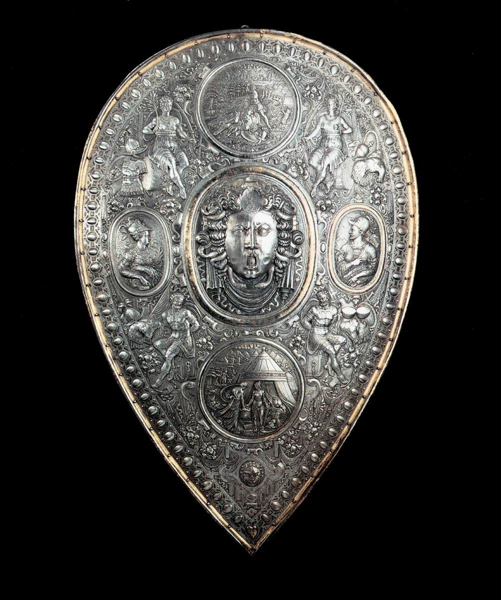 Shield for Francesco I de' Medici, c1570 - a chased morion and shield, now kept in Dresden, attributed to Benvenuto Cellini_ In the centre of the shield the head of Medusa can be seen, while the two ovals show the portrayal of Francesco de.jpeg