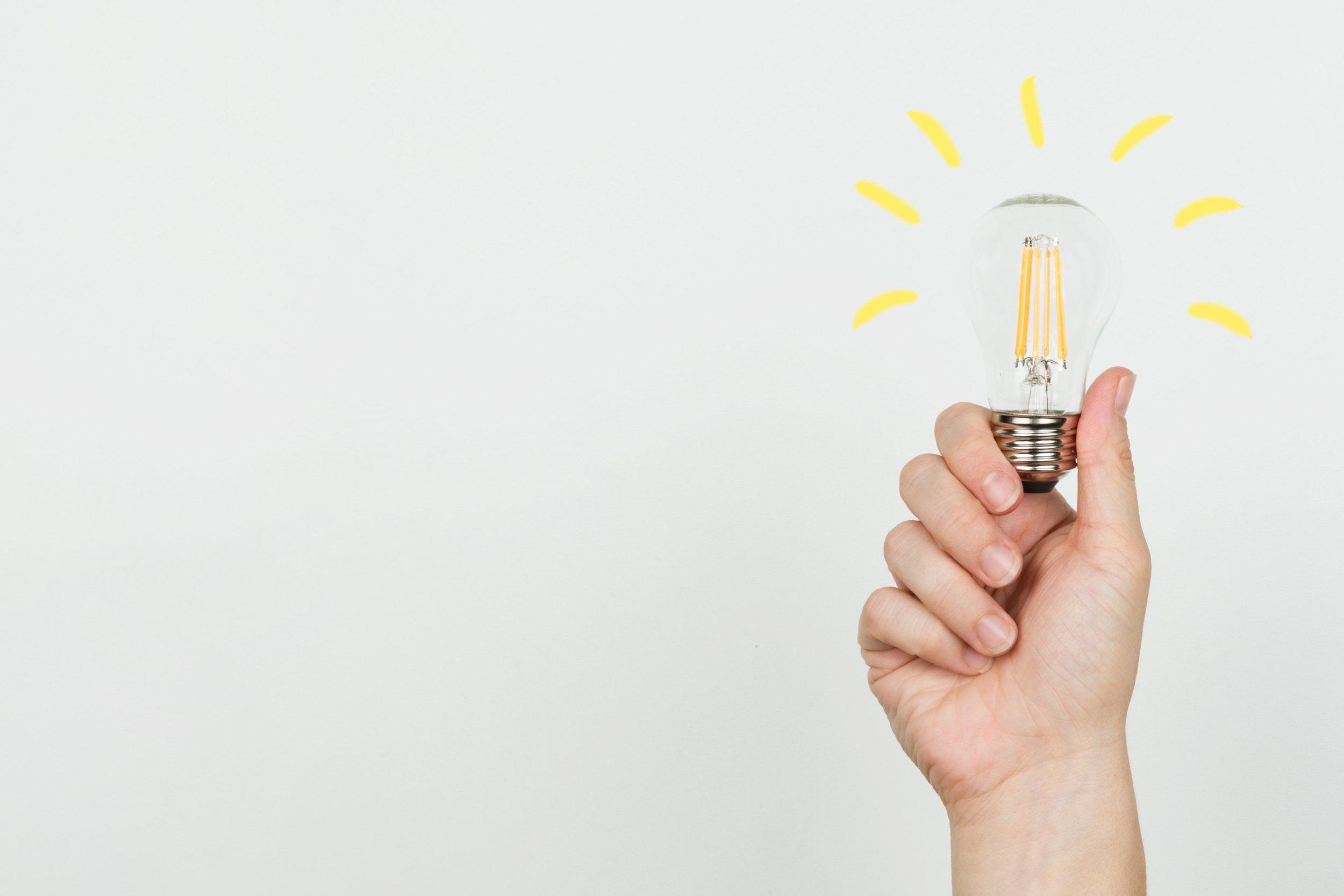 hand-with-idea-lightbulb_4460x4460.jpg