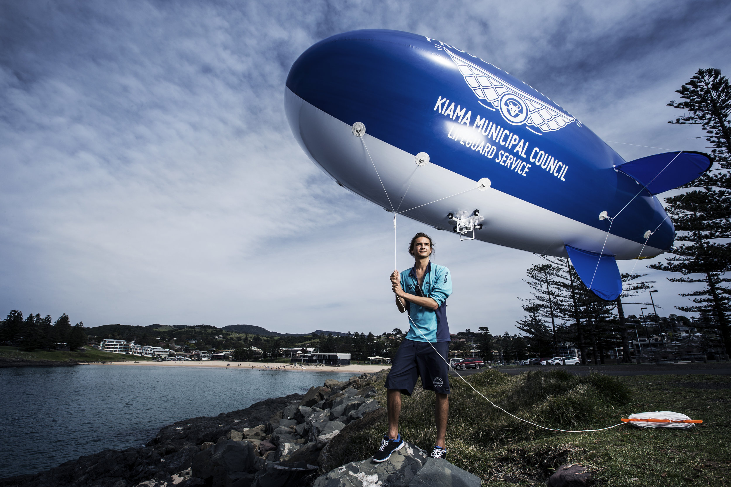 Lifeguard and marine biologist Kye Adams at Kiama Beach, NSW, with his blimp-mounted camera system for spotting sharks