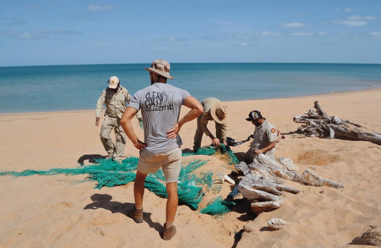 A team works to remove a discarded fishing net from Chilli Beach, Cape York (Image: Clean Coast Collective)