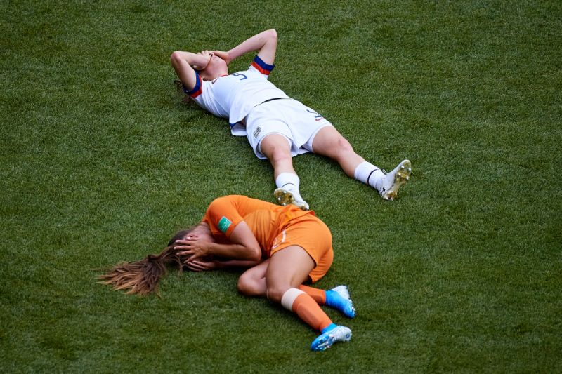 Lieke Martens and Kelly O'Hara after colliding as they attempted to head a ball