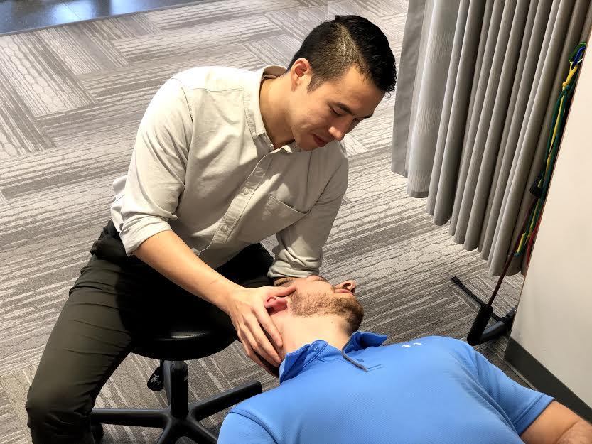 The author, Justin J Ho PT, DPT, CSCS, treating BPPV