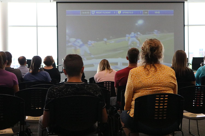 Attendees of the Northwest Brain Injury Symposium watch the video CrashCourse by TeachAids
