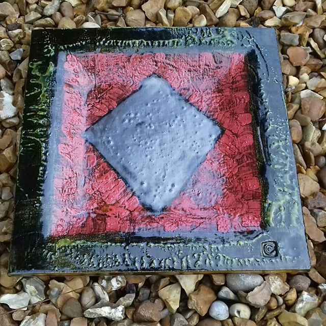 """Slpware plate (shallow square dish) with diamond motif by Mike Cain. 30 cm x 30 cm. Mike said """"If my work seems different from most studio ceramics it is because I am not a studio potter.  I have come from the world of painting and sculpture that in turn is fed by the whole of art history."""" Come and see more of Mike's work at SCAR: From the Rich Earth. The exhibition is at Valentine's Clays Stoke-on-Trent from Oct 3rd to Nov 29th 2019. #abstraction #abstractart #slipware #penkhullartists #ceramicart #slabpottery #ScarRichEarth #valentinesclays #penkhullartists #scargroupstoke #slabpottery #pottery #platters"""