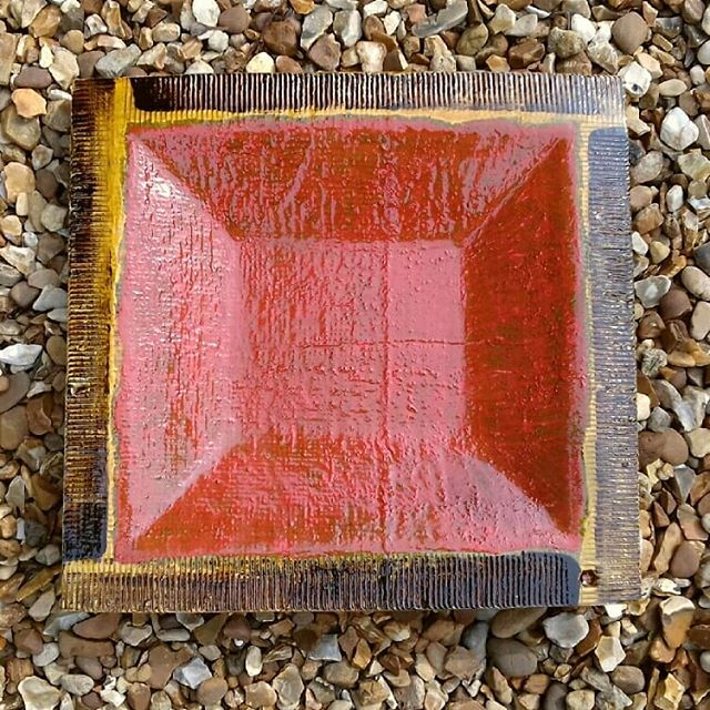 """Slipware plate / shallow bowl. 35 cm x 35 cm. Red / orange square inside a yellow & black border by Dave Harper. """"This is one of a series of pieces I've made using a simple square motif which allow colour and texture to come to the fore. The original yellow and back slips have been added to with the use of various oxides and stains. These have produced a complex colour range which includes greens, yellows, with red and orange"""" said Dave #abstraction #abstractart #slipware #ceramicart #penkhullartists #slipwarepottery #pottery #abstract #texture #scargroupstoke #artceramics #scargroup"""
