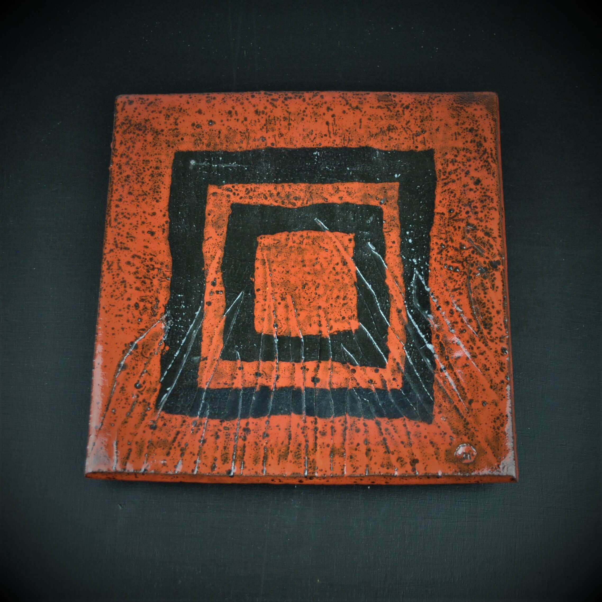 Dave Harper 2018 Slipware plate 25 cm x 25cm. Black squares on red. On black background (Square edit) DSC_6355 (2).JPG