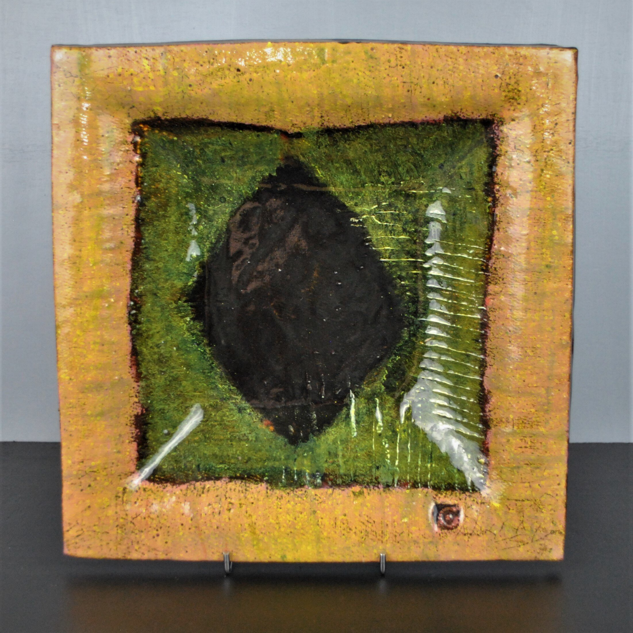Mike Cain 2018. Square slipware dish with a black diamond on green. On stand. (Square edit) DSC_6265 (2).JPG