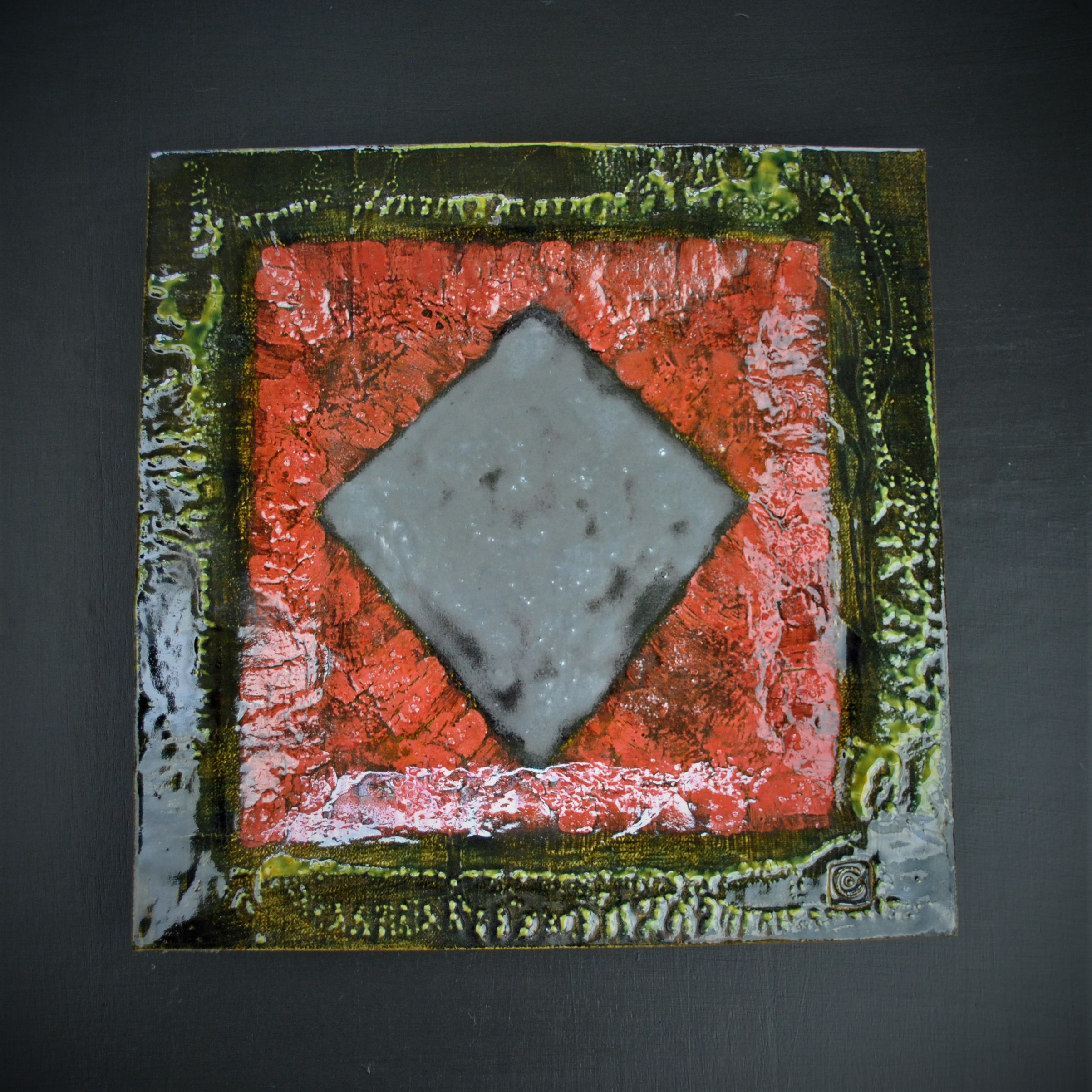 Mike Cain 2019 Silver diamond on red with green border. (Square edit) DSC_6219 (2).JPG