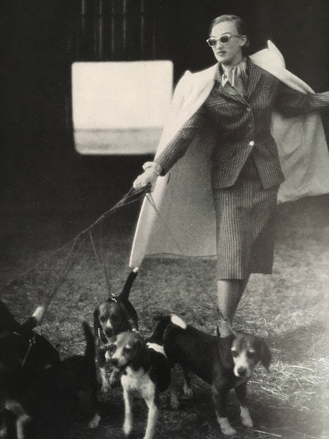 Walking the pets.     Who's leading whom?    Vogue. July 1, 1947.
