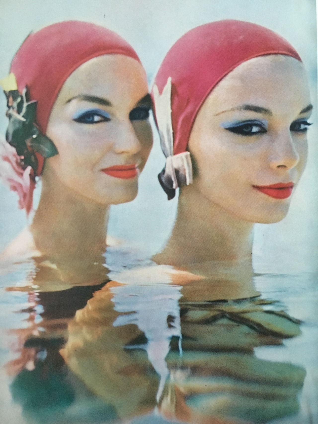 Vogue. June 1957.     Today's prompt was symmetrical, so I found these in sync bathing beauties.