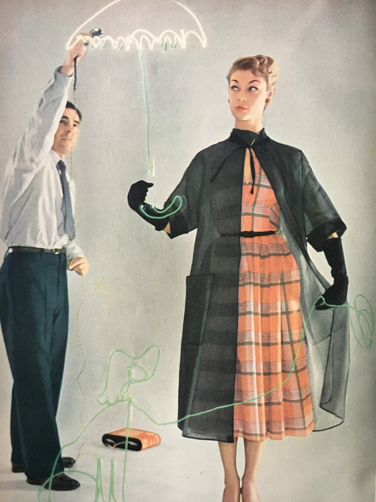 """""""In the air: sheers.""""     Fashion editorial.     Mademoiselle. June 1950.     It's a bit of a rainy day here in New York, so don't forget your umbrella!"""