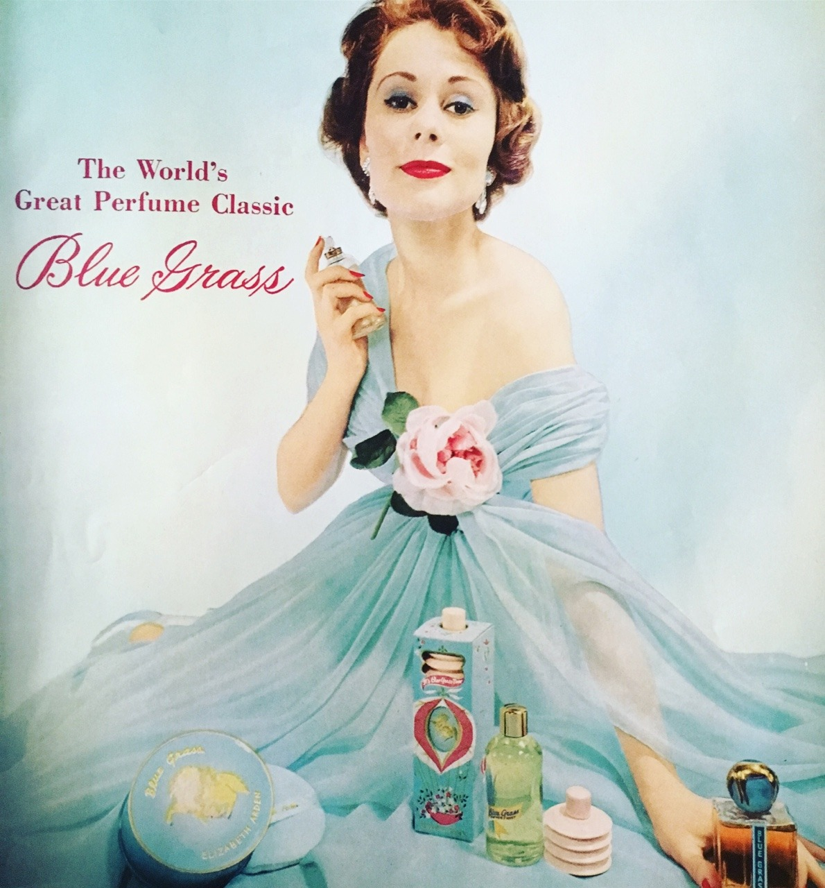"""Blue Grass by Elizabeth Arden.   Vogue. June 1957.     The iconic Blue Grass fragrance was introduced in the 1930's and was inspired by the fields where Arden bred her famous Thoroughbreds. Arden was also famous for her rivalry with fellow self-made cosmetic powerhouse Helena Rubinstein, which has been turned into a new musical on Broadway called """"War Paint."""""""