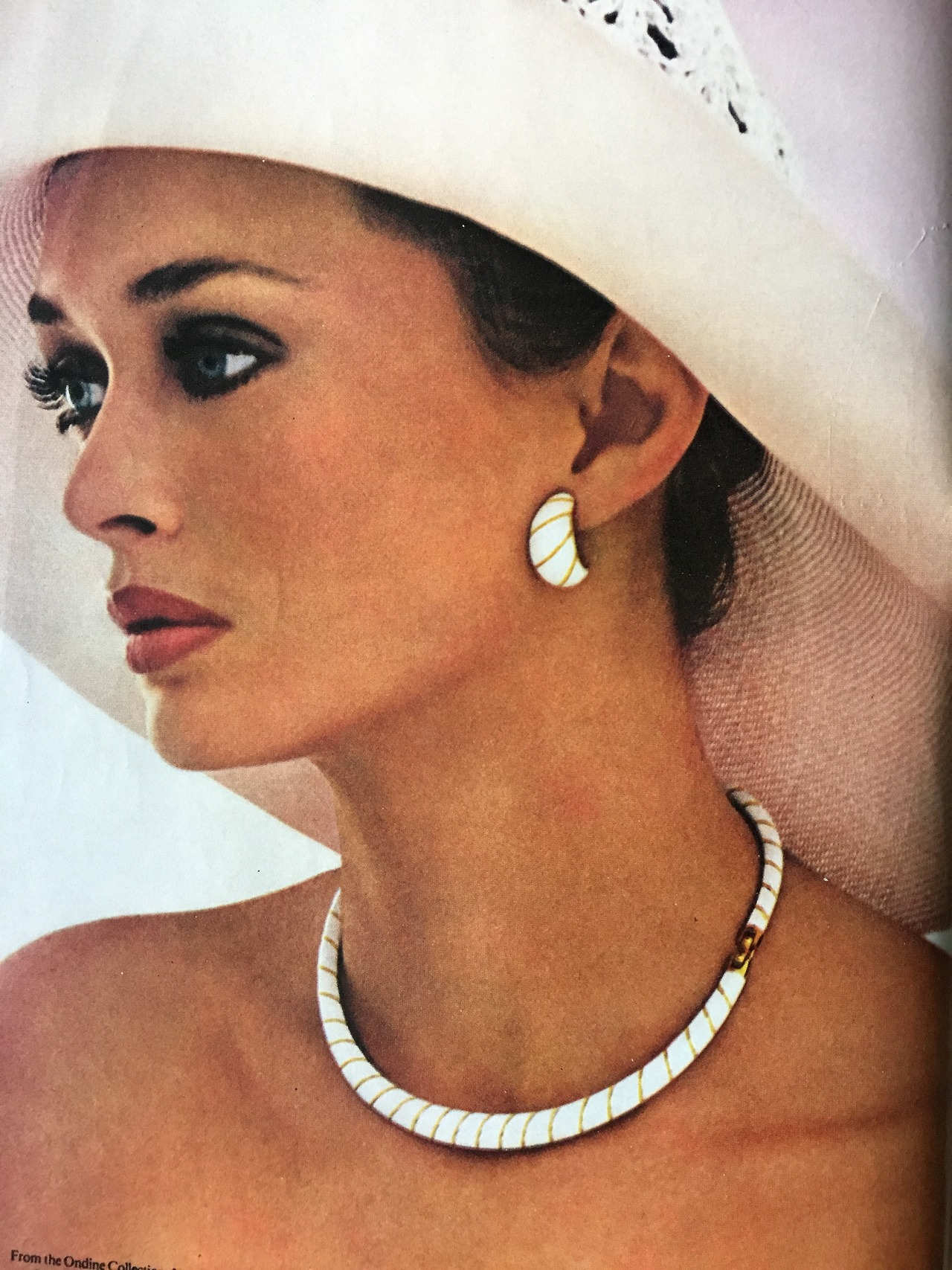 Monet jewelry ad detail.   Vogue. May 1978.