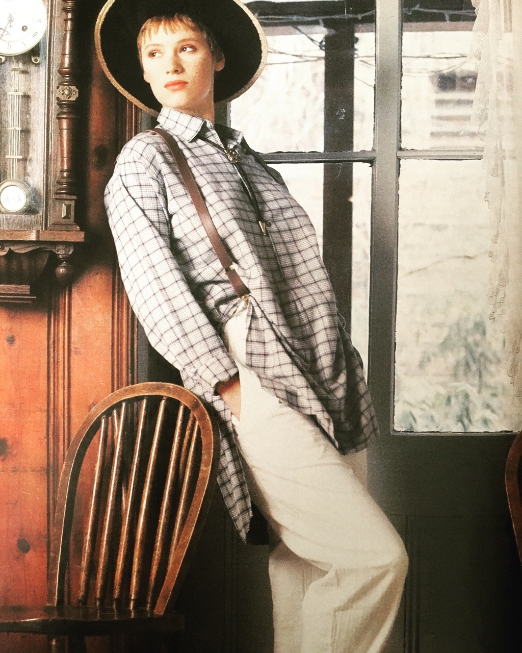 """""""Liddie looks both beautiful and mischievous in a longer, looser  windowpane-plaid shirt that spills over quilted cotton pants.""""  From """"The New American Style""""     Seventeen. May 1985."""