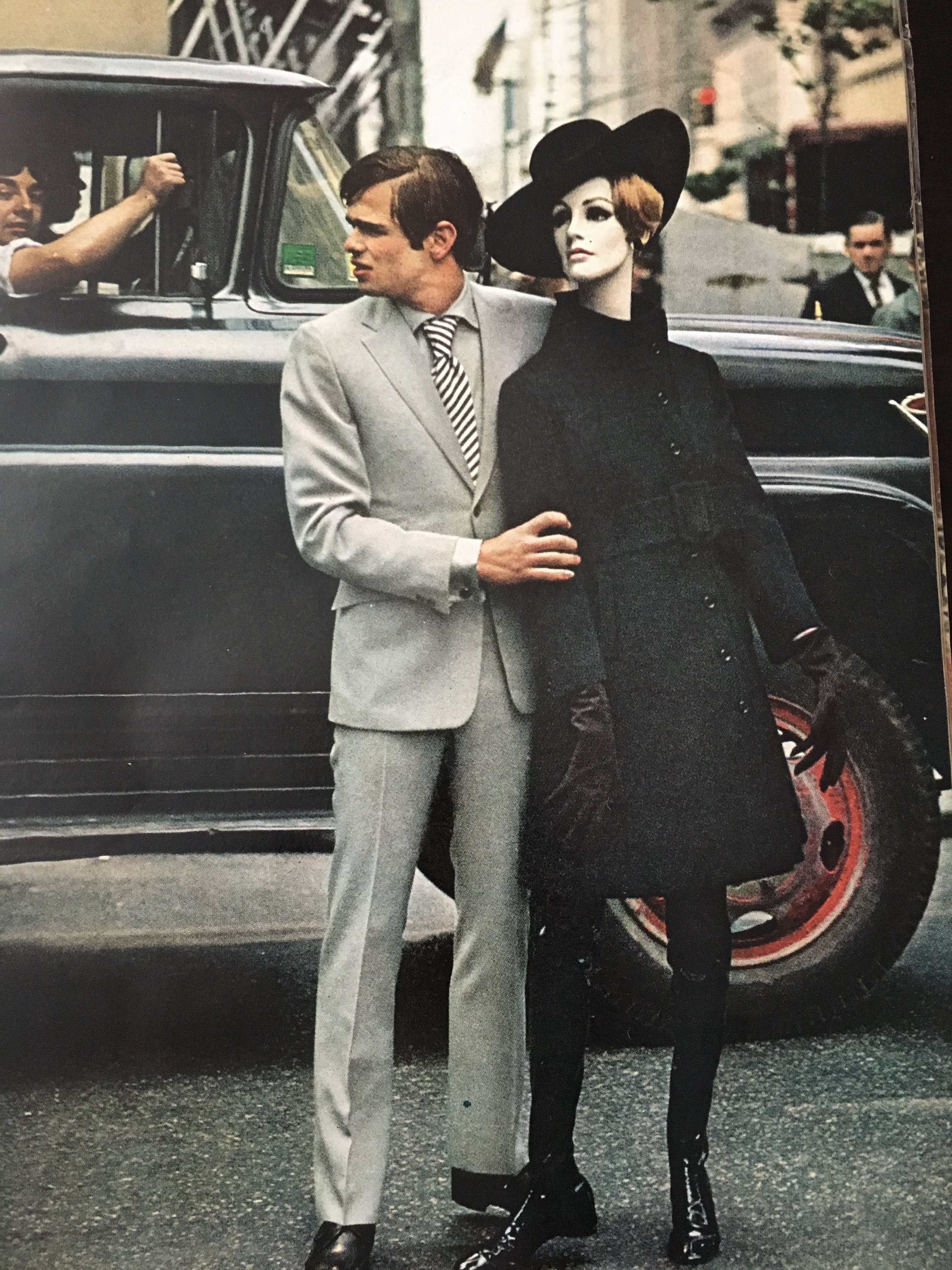 The all-black look. She's in ebon from hat brim to boot, her wool coat high-belted. He's in pearl gray - suit and shirt.