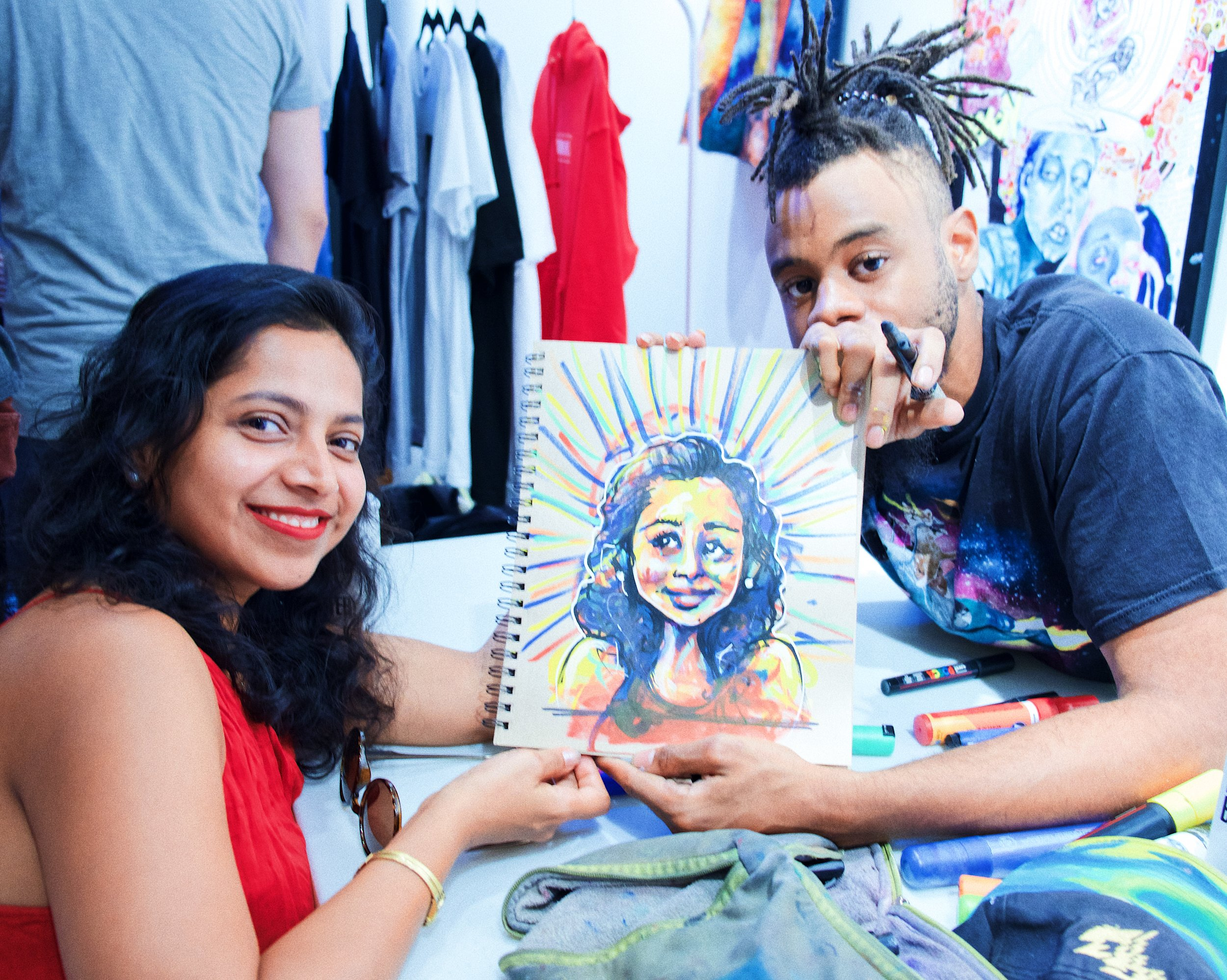 Kahiem Archer did portraits of the guests all evening - here's fitness entrepreneur, Auroshikha, of Zydness is loves her masterpiece.