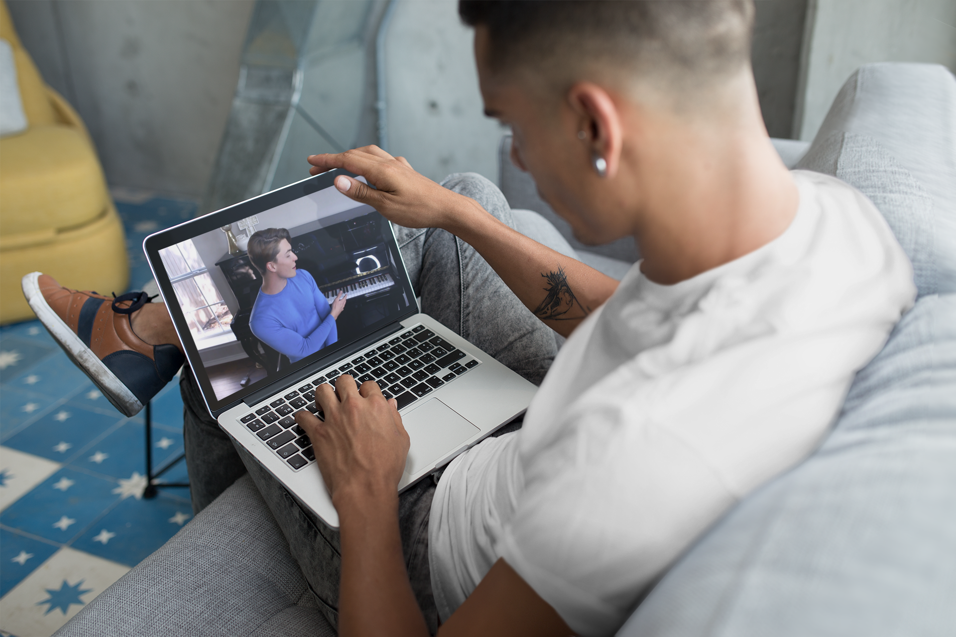 man-using-a-macbook-mockup-sitting-on-a-couch-a20757.png