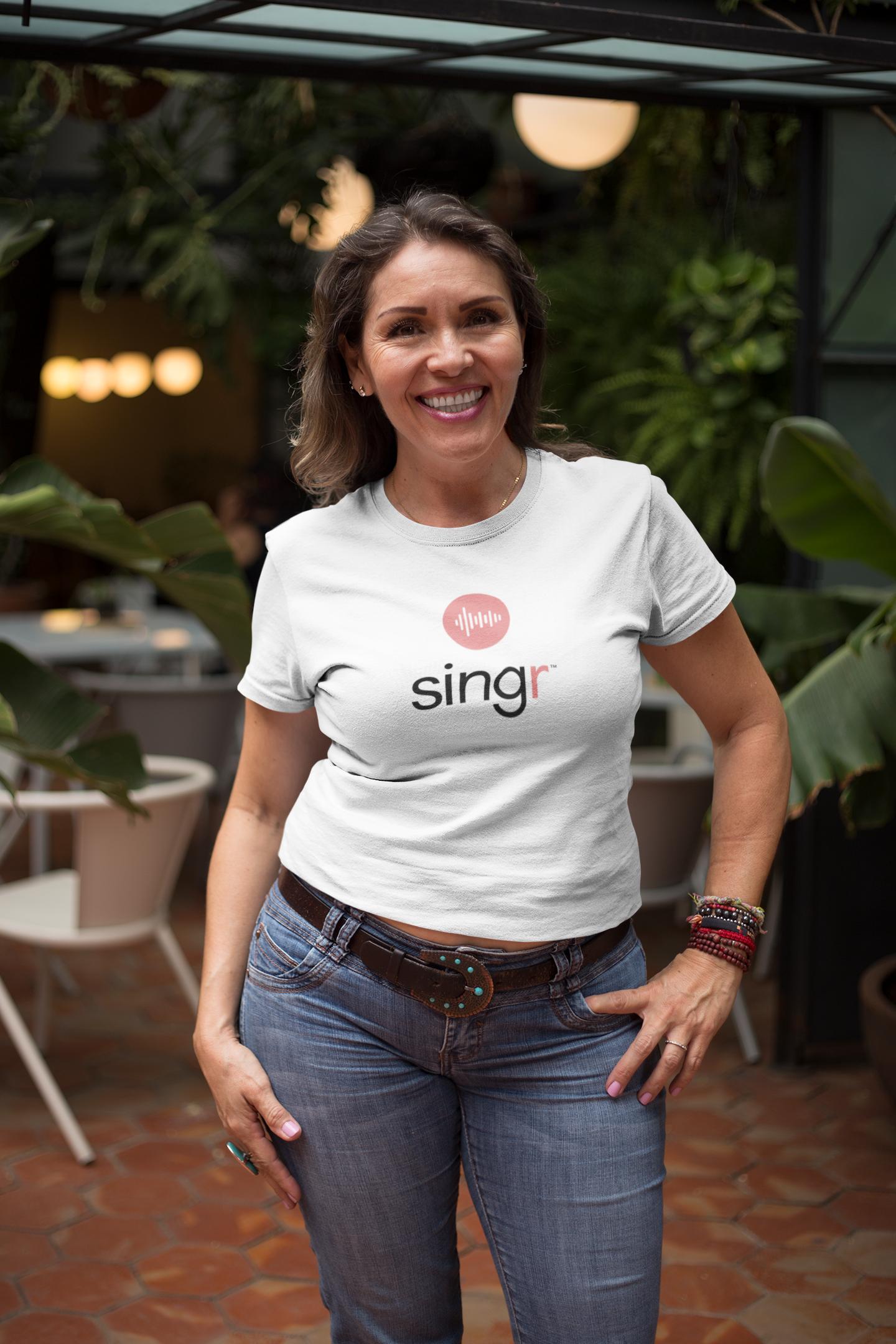 senior-woman-posing-wearing-a-t-shirt-mockup-at-a-coffee-shop-a20364.png