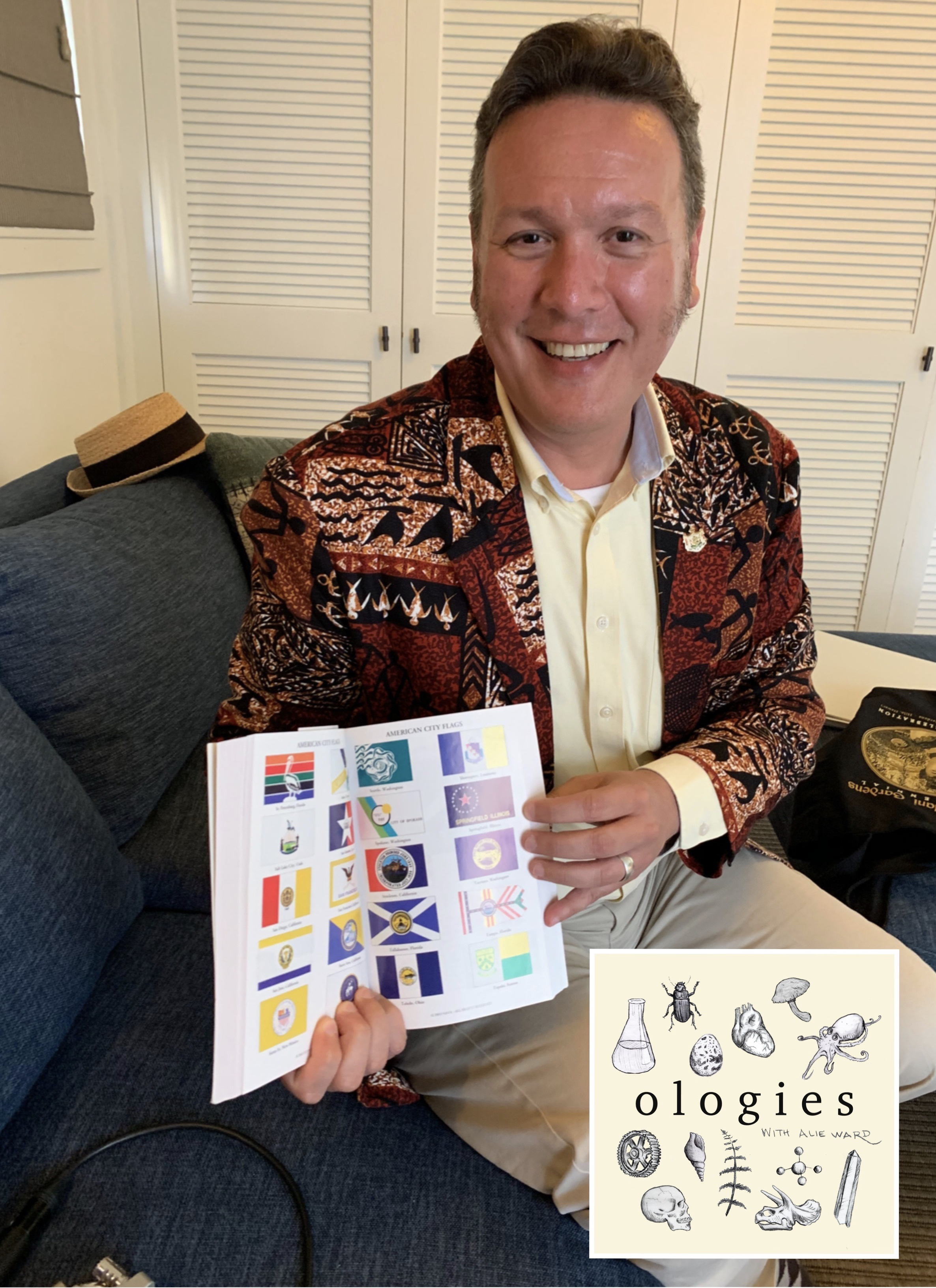 Sharp-dressed Honolulu vexillologist E. Tory Laitila brought along a book on flags and flag codes.