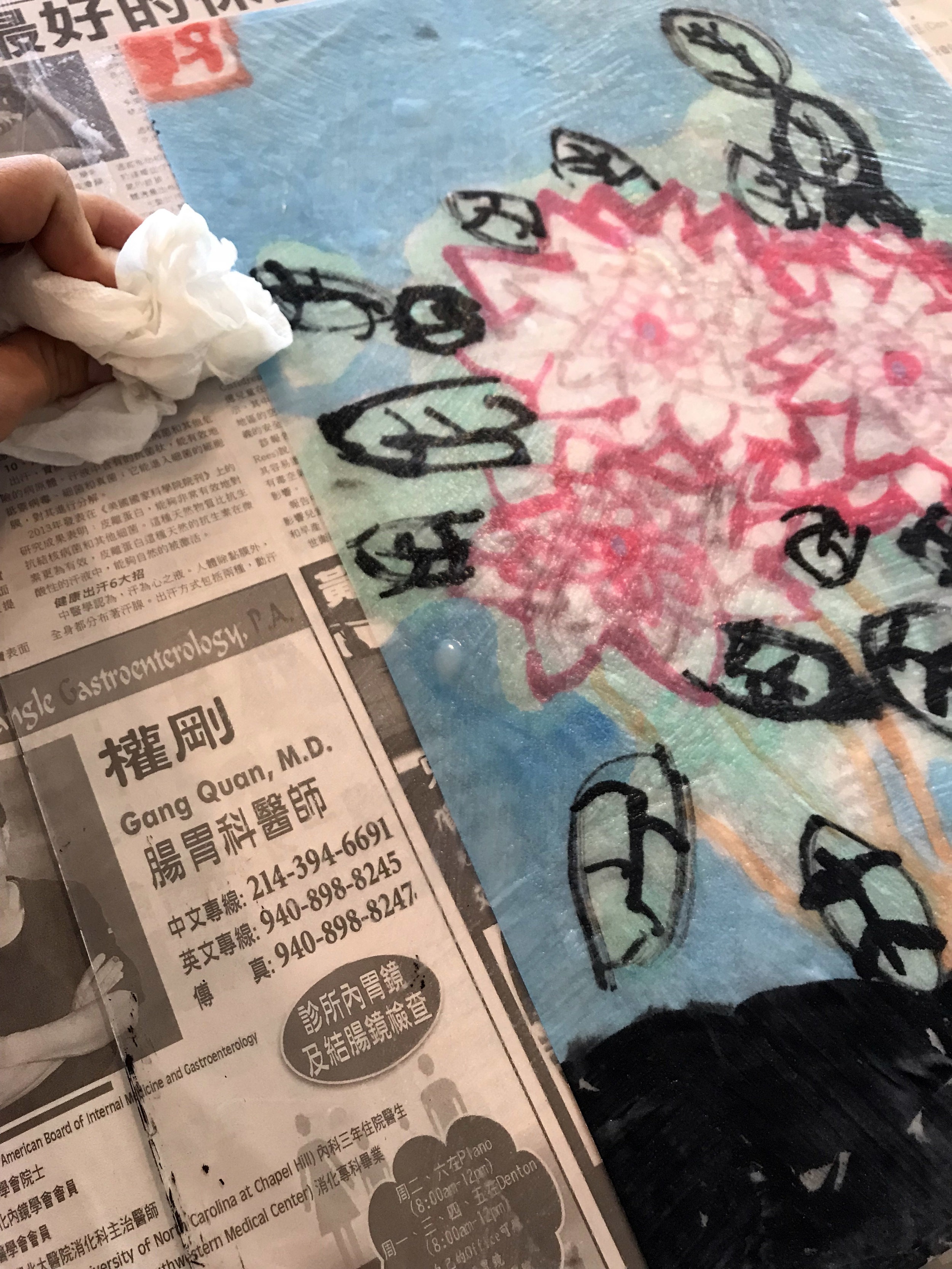Applying the paste on plexiglass.
