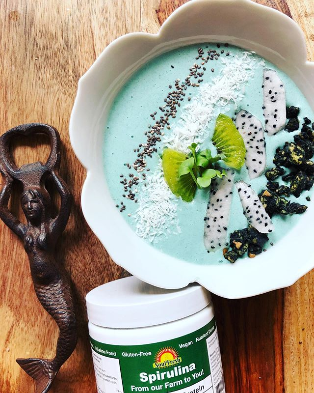 """Spirulina! . @soulfresh.proteins . 🌱 Plant Based Protein Farm Fresh in The USA 🌱 . Spirulina is a nutrient dense blue-green algae """"high in protein, iron, calcium, antioxidants, beta-carotene and has anti-inflammatory properties. . It is grown in a greenhouse in glass tubes utilizing sunlight for photosynthesis."""" . 🍵You may have heard of Spirulina as a supplement to add to your smoothie or juice for protein and antioxidant/anti inflammatory kick 🌱 . We made a smoothie bowl that is simple, delicious & nutritious! . Mermaid 🧜🏻♀️ Bowl Recipe: . ➡️1 Cup Plain Greek Yogurt (Yogurt of choice) ➡️1 Frozen Banana 🍌 ➡️1 Tsp. Spirulina . Blend until smooth. Garnish! We used dragon fruit, kiwi, chia seeds, coconut & CrunchLina (a Spirulina Granola). . 🌱Link in Bio for 10% Off 🌱"""