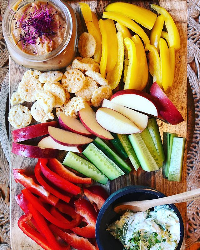 Charcuterie Boards! Snack Boards! . They don't need to be fancy or complicated or even have meat on them to join in on the fun! . We love this family style of eating. These are perfect for a light lunch or putting out before a meal to tide the kids (or yourself) over before the meal is ready. . Family style trays on the table encourages kids to self feed and regulate what and how much they want to eat. The more variety and colors the better! . This simple Lunch Board contains many of my children's favorites: cucumbers, @whisks snacks, bell peppers & apples. . Bean dip made from garbanzo beans blended with salsa and topped with @sweetcitymicros Amaranth Microgreens. . Cream cheese mixed with lemon zest, fresh garlic and peashoot micro-greens make up the second dip. (Can use @kitehillfoods Dairy Free Cream Cheese) . Great way to use up fridge and pantry left overs!