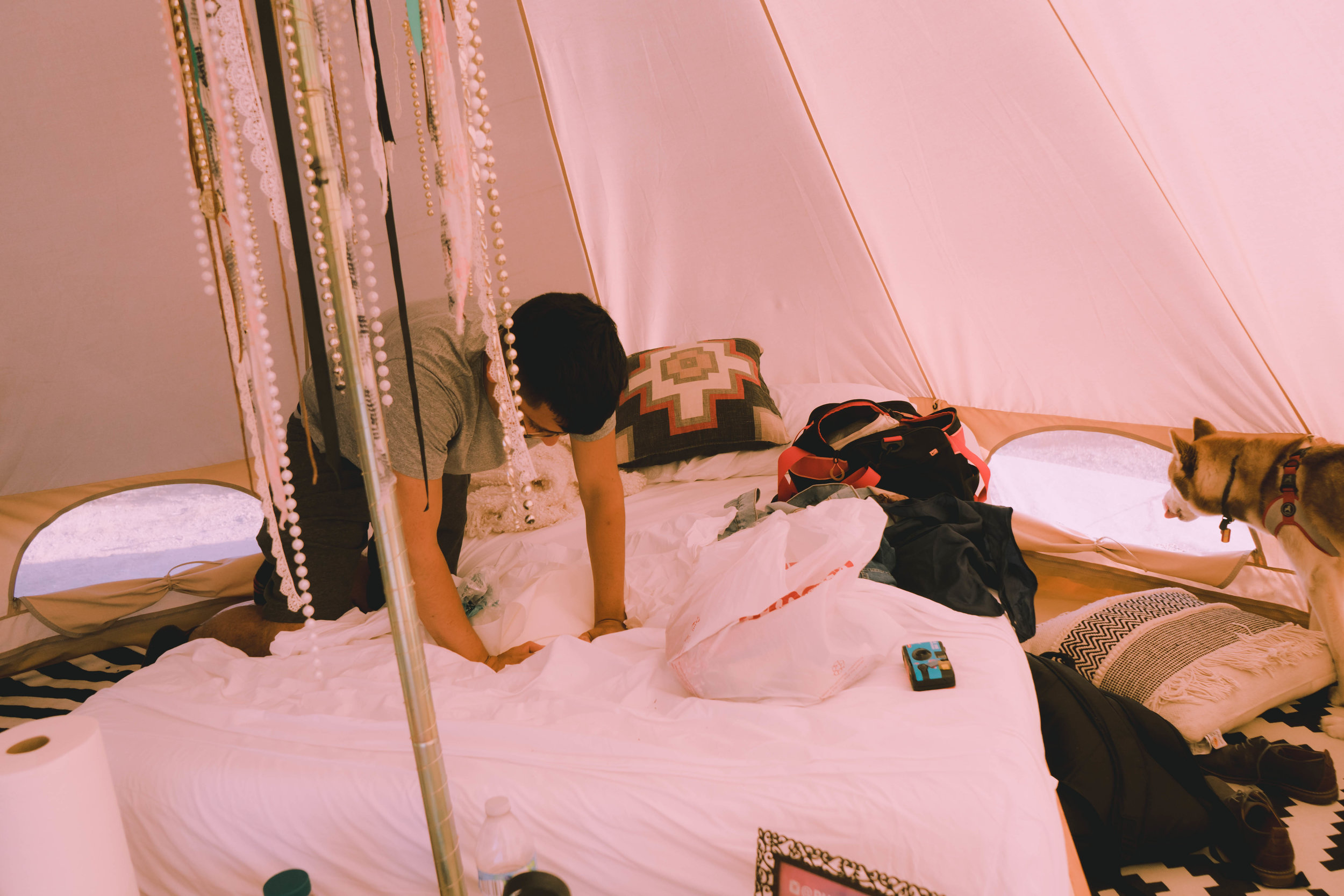 Inside of the Aquarius tent, complete with bed and other bedroom essentials