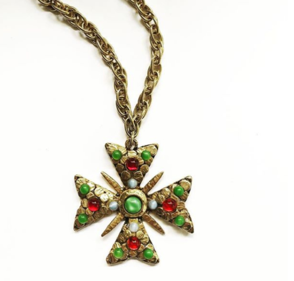 A really fun 60s vintage Maltese cross pendent. A very popular design motif from the 1960s. The chain is a great length. This piece is in excellent condition. $125