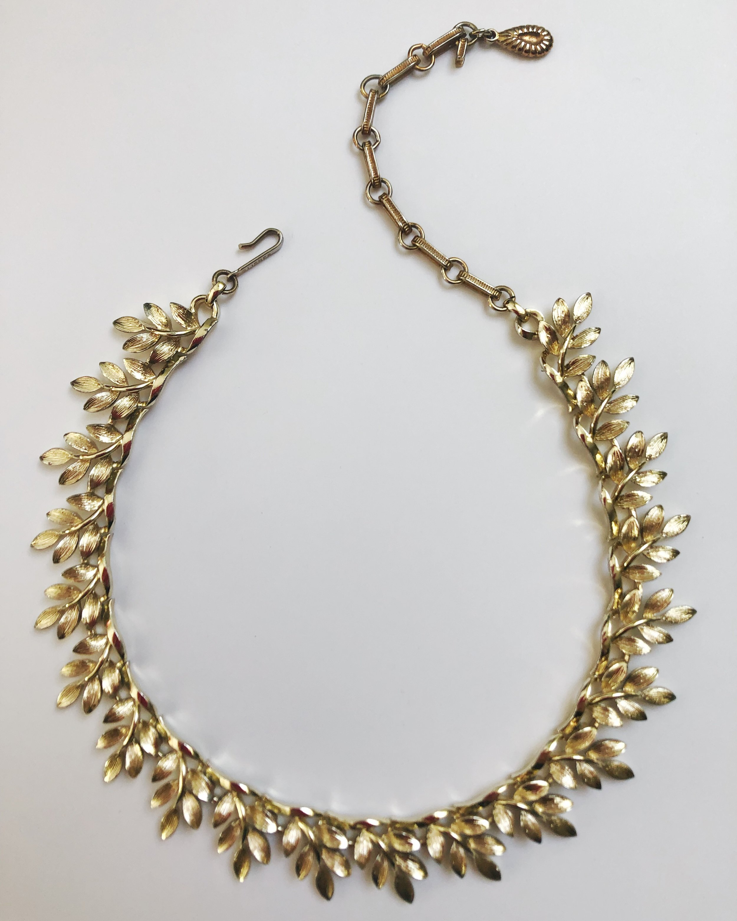 Beautiful goldtone collar necklace. 1950s. Signed, Lisner. $120