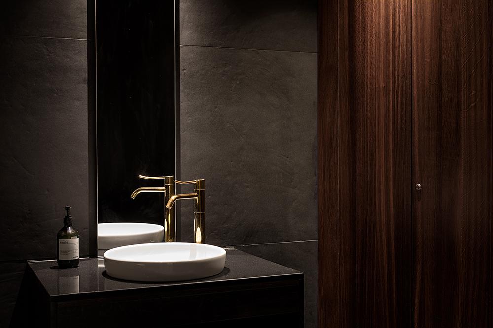 Hotel Brosundet Bar Ålesund Norway, Modern and minimalist bathroom sink with brass water tap  , interior design by GARDE. Mads Emil Garde